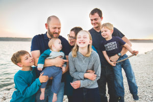 family photo by lake - Lyndsay Stradtner - Life In Motion Photography - Family Travel Photographer