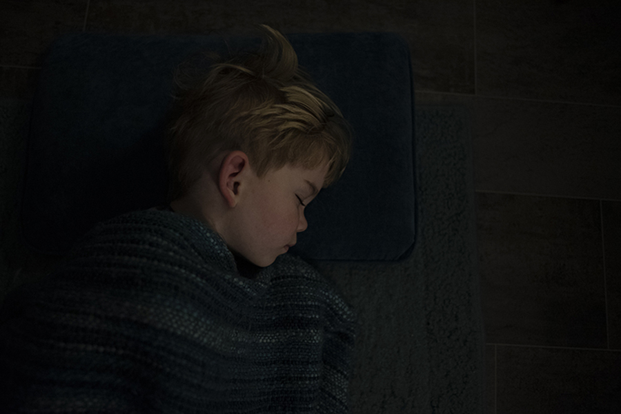 jonah sleeping on the floor under a blanket - before editing services