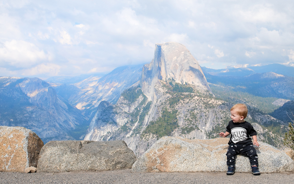 zachary sitting on a rock with half-dome in the background. Found on the Contact page for Life in Motion Photography.