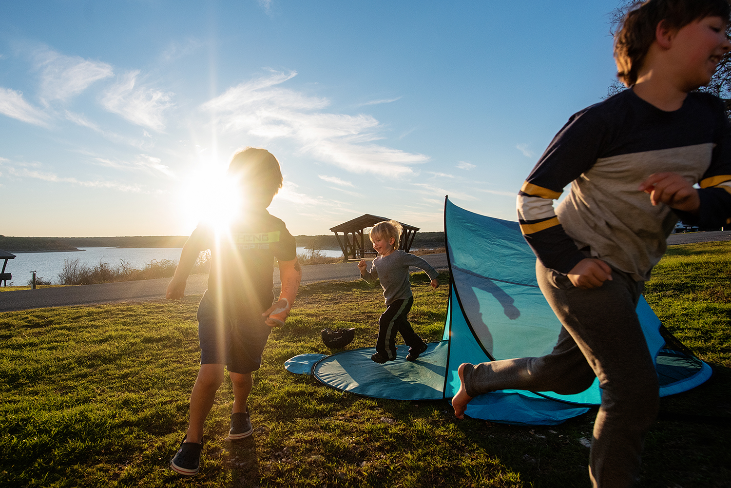 photo of boys playing in tent at sunset