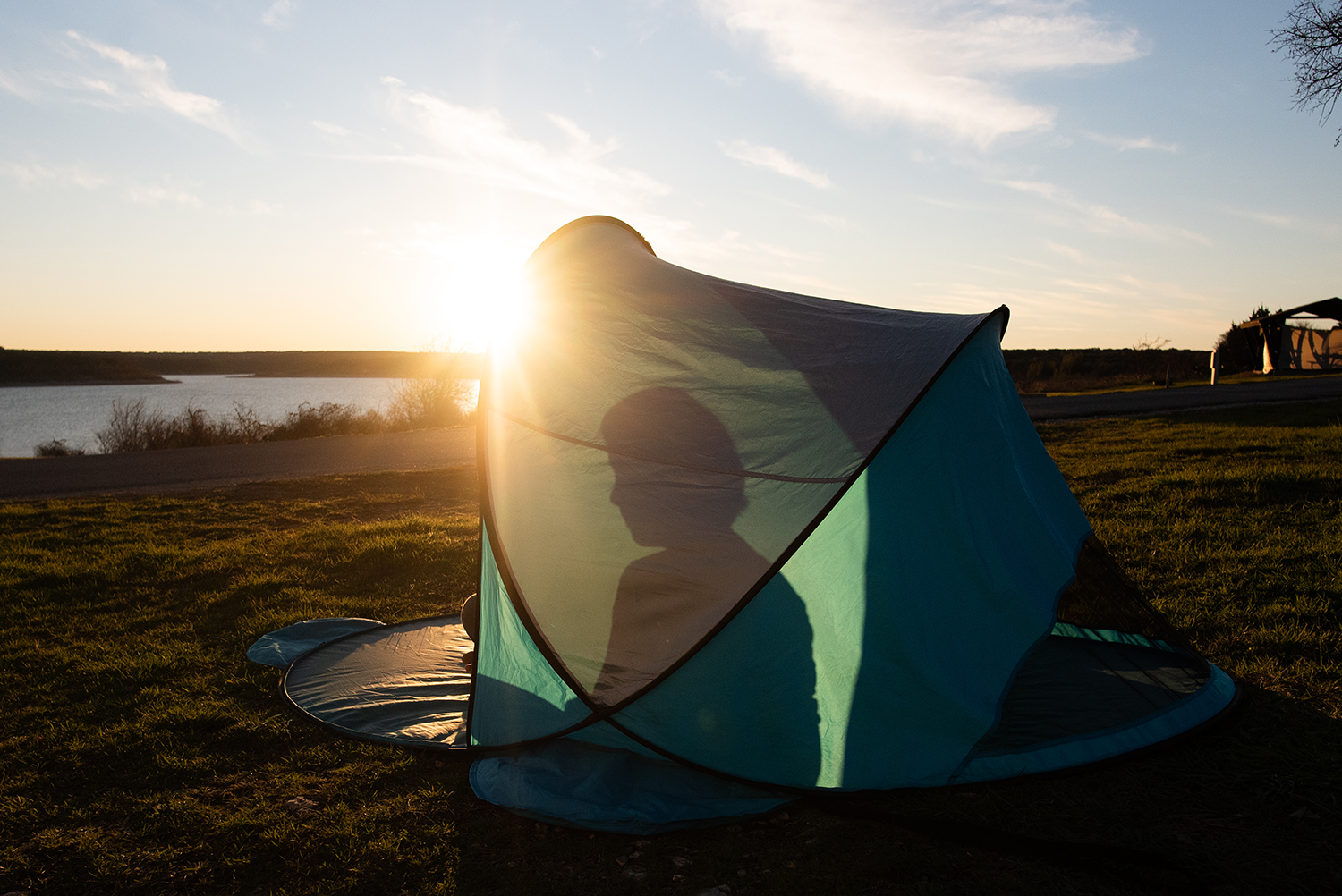 boy in tent at sunset photo