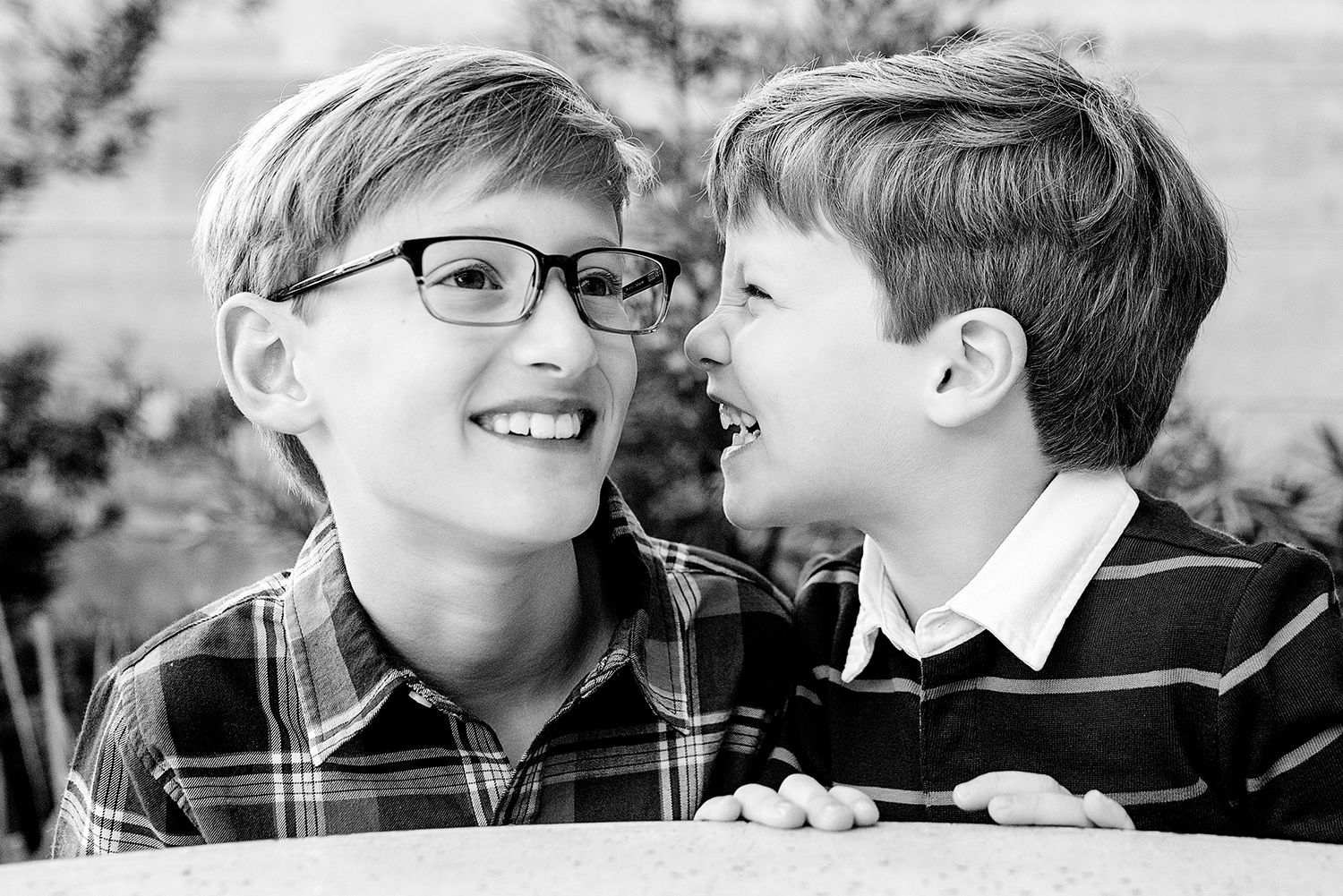 austin family photo of 2 brothers laughing